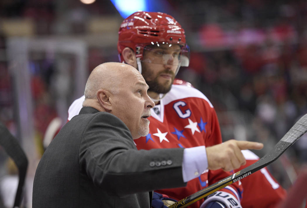 Washington Capitals head coach Barry Trotz, front, points next to Alex Ovechkin, back, of Russia, during the third period of an NHL hockey game against the Detroit Red Wings, Friday, Nov. 18, 2016 ...