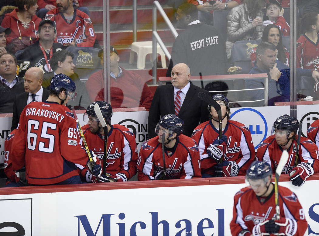 Washington Capitals head coach Barry Trotz, top, looks on during the first period of an NHL hockey game against the Pittsburgh Penguins, Wednesday, Jan. 11, 2017, in Washington. The Capitals won 5 ...