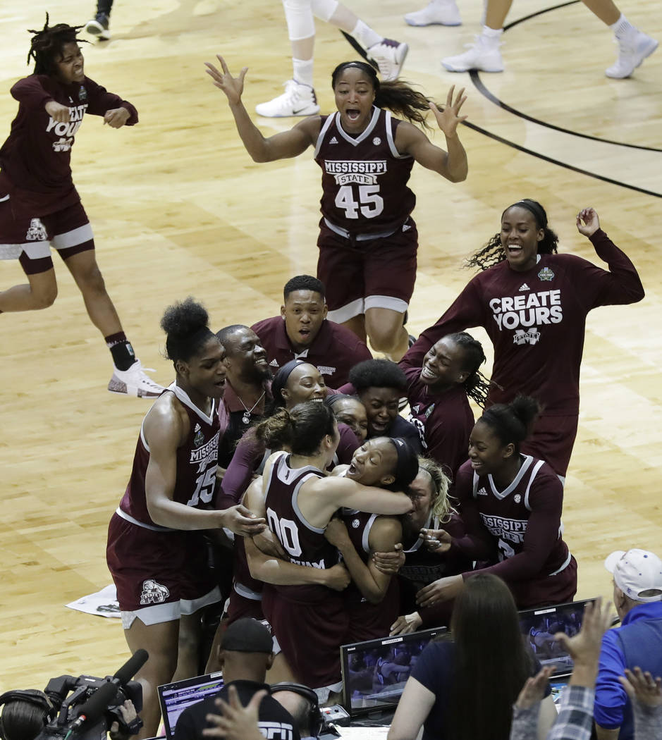 Mississippi State guard Morgan William, center, celebrates with teammates after she hit the winning shot at the buzzer in overtime to defeat Connecticut in an NCAA college basketball game in the s ...
