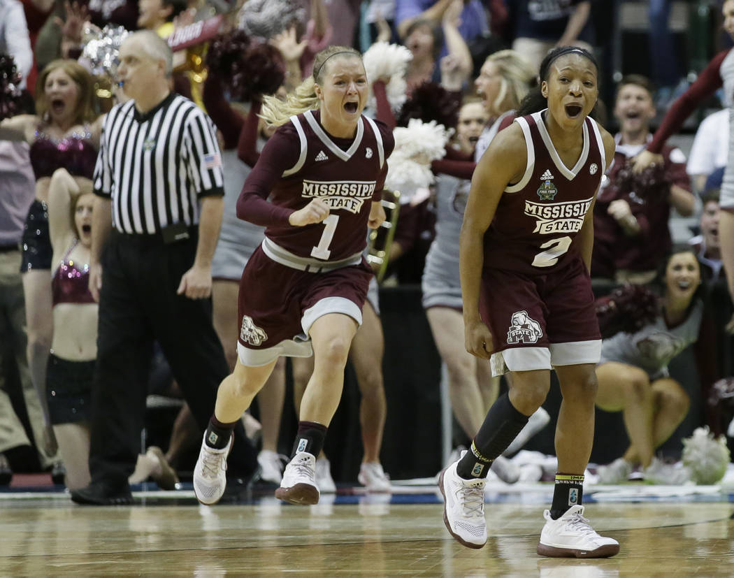 Mississippi State guard Morgan William (2) celebrates after she hit the winning shot in overtime to defeat Connecticut in an NCAA college basketball game in the semifinals of the women's Final Fou ...