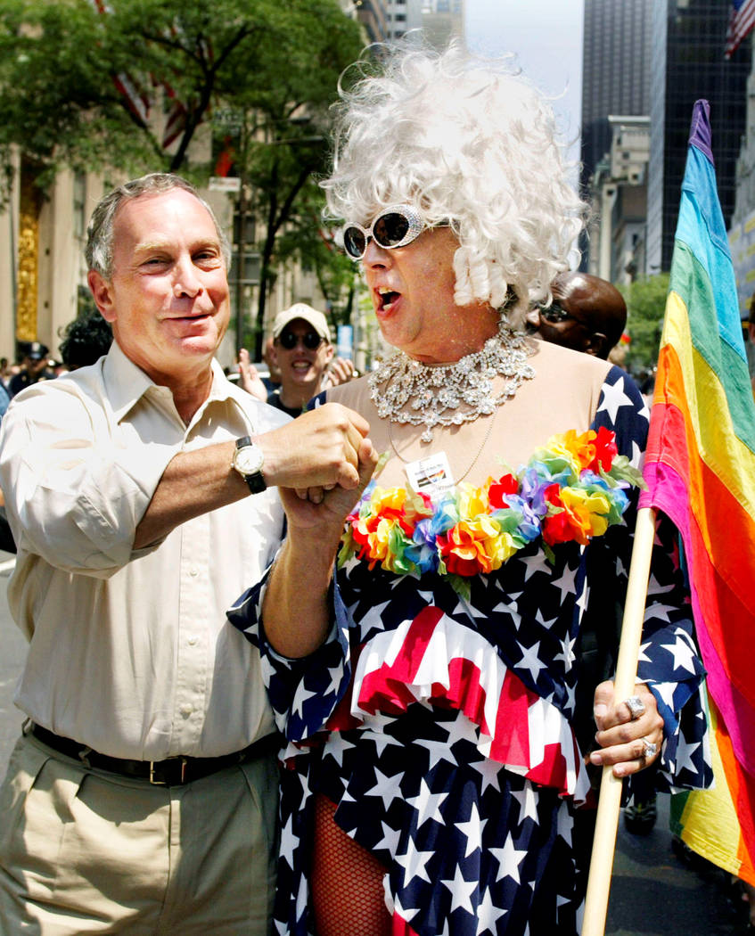 New York Mayor Michael Bloomberg greets Gilbert Baker as they take part in the annual Gay Pride parade in New York City, June 30, 2002. Jeff Christensen/Reuters