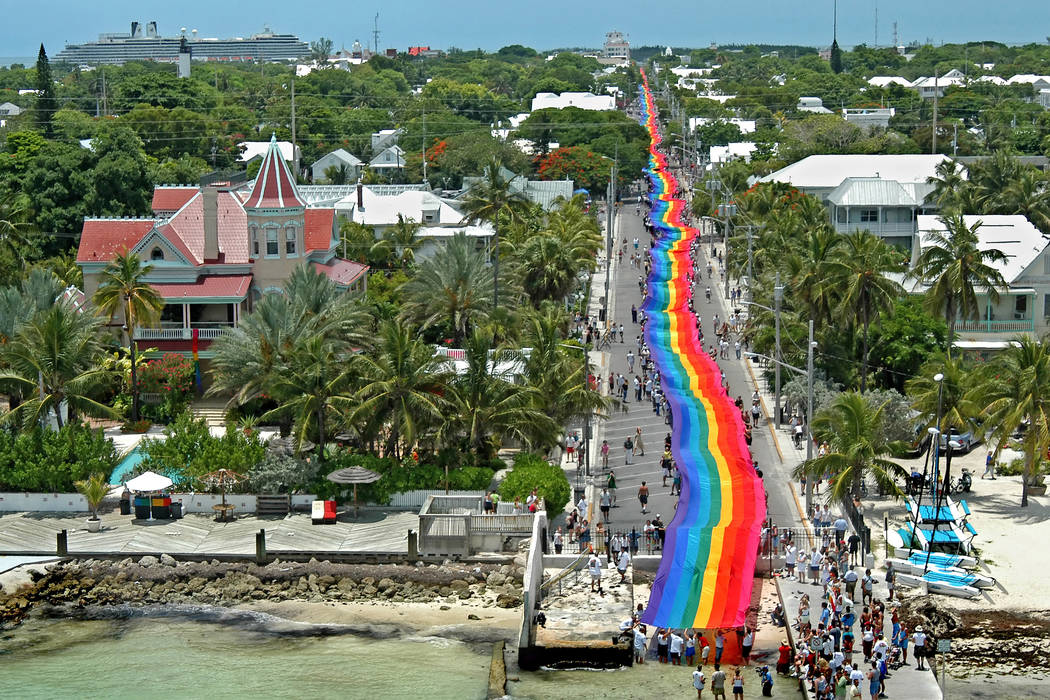 A 1 1/4-mile-long rainbow flag created by Gilbert Baker is carried down Duval Steet in Key West, Florida, U.S., June 15, 2003. The flag commemorated the 25th anniversary of the iconic flag that Ba ...