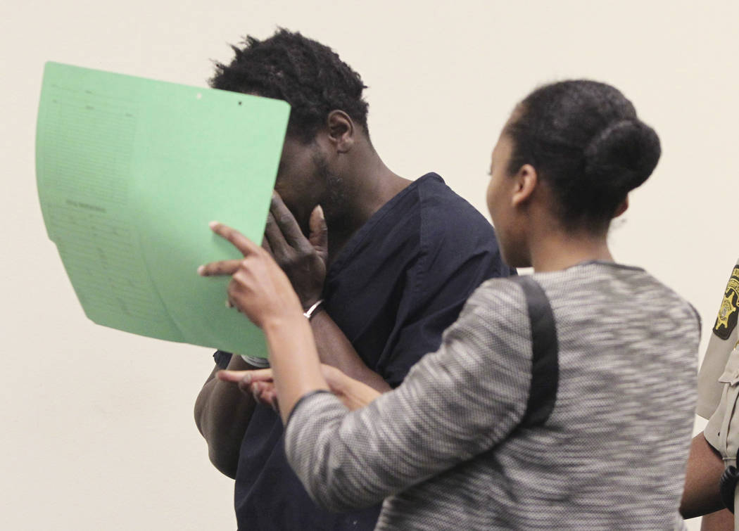 Basil Eleby is escorted out into the courtroom by his public defender and two Fulton County Sheriff's office officers at the Fulton County Jail in Atlanta on Saturday, April 1, 2017. (Henry P. Tay ...