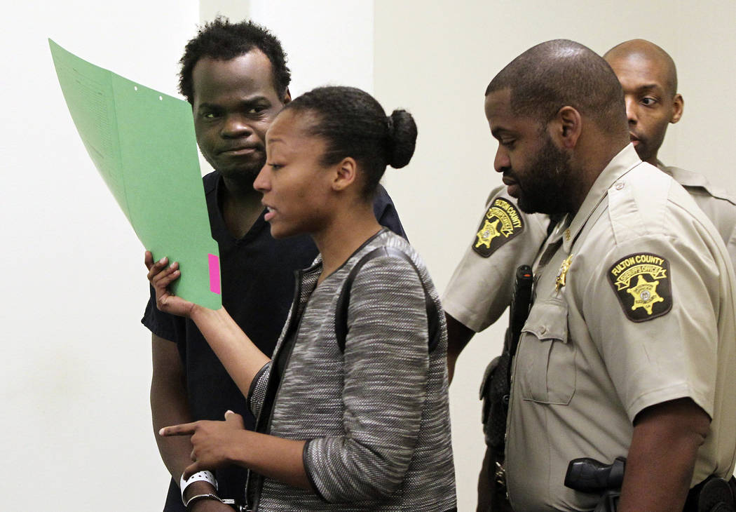 Basil Eleby is escorted by his public defender and two Fulton County Sheriff's office officers into the court room at the Fulton County Jail in Atlanta on Saturday, April 1, 2017. (Henry P. Taylor ...