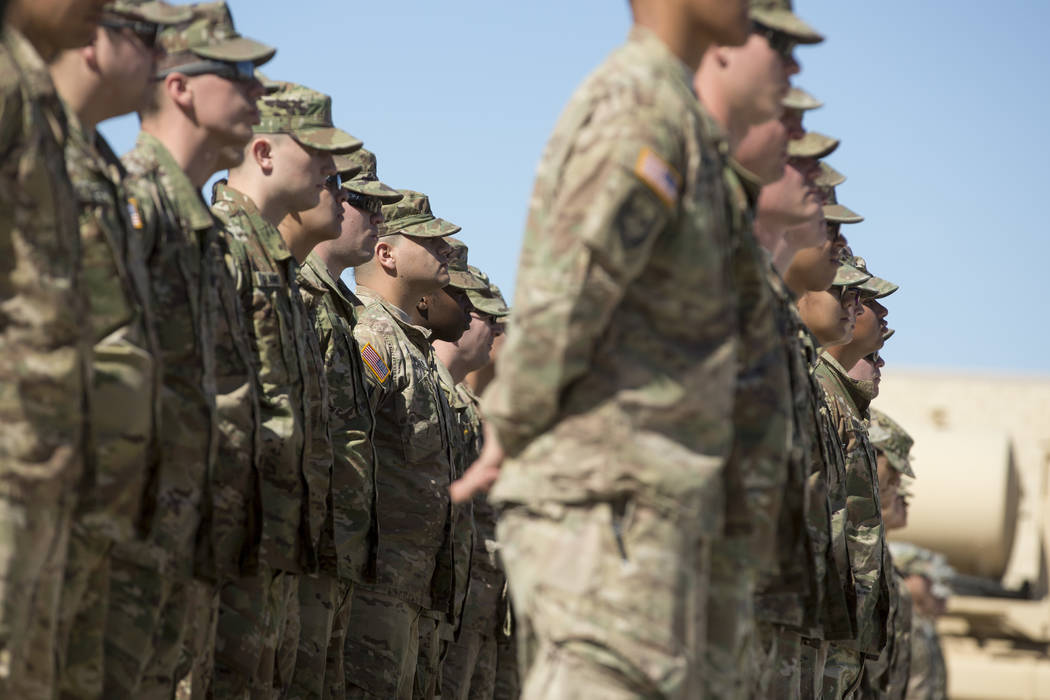 The 17th Sustainment Brigade stand at attention during the change of command ceremony at the North Las Vegas Readiness Center on Sunday, April 2, 2017, in North Las Vegas. (Bridget Bennett/Las Veg ...