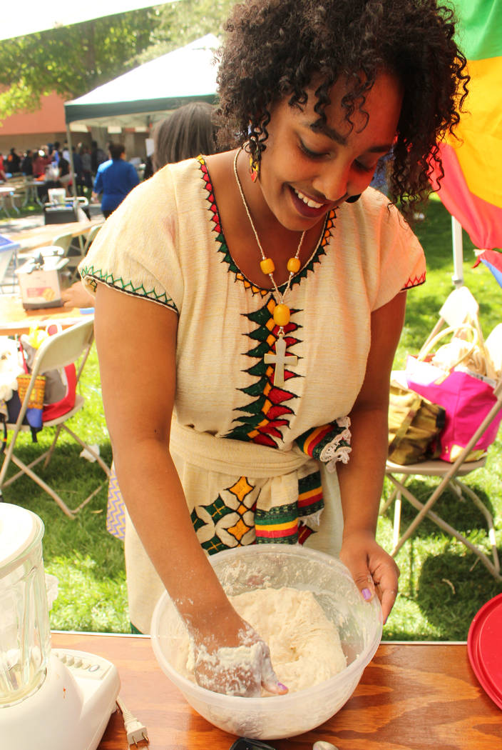 Habesha Student Association member Eyrusalem Sifir kneads dough for a deep fried dish during the Festival of Communities at UNLV, Saturday, April 1, 2017. (Gabriella Benavidez Las Vegas Review-Jou ...
