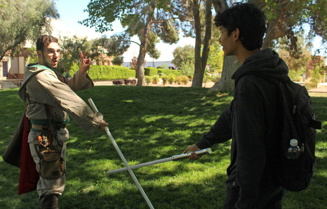 UNLV student Ryan Wilgeroth, left, a member of the Society of Lightsaber Duelists, trains Del Sol High School junior Carlo Sandoval, 16, during the Festival of Communities at UNLV, Saturday, April ...