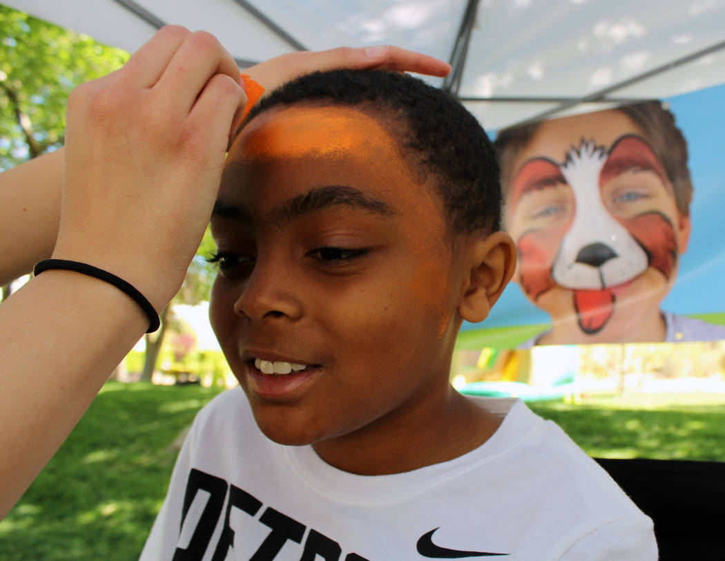 Manuel Puno, 9, gets his tiger face paint started during the Festival of Communities at UNLV, Saturday, April 1, 2017. (Gabriella Benavidez Las Vegas Review-Journal) @gabbydeebee