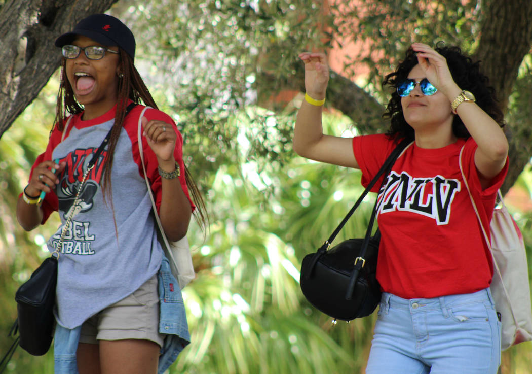 Canyon Springs High School seniors Alma Romero, 18, left, and Kayanna Miller, 18, follow a zumba lesson during the Festival of Communities at UNLV, Saturday, April 1, 2017. (Gabriella Benavidez La ...