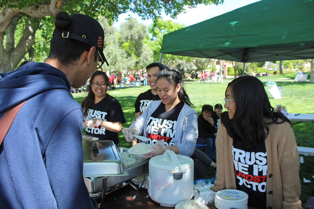 Members of the American Medical Student Association at UNLV serve food during the Festival of Communities, Saturday, April 1, 2017. (Gabriella Benavidez Las Vegas Review-Journal) @gabbydeebee