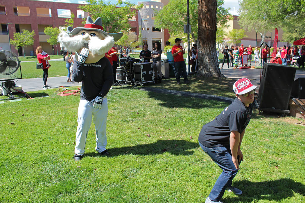 Clayton Rhodes, right, dance battles UNLV mascot Hey Reb! during the Festival of Communities at UNLV, Saturday, April 1, 2017. (Gabriella Benavidez Las Vegas Review-Journal) @gabbydeebee
