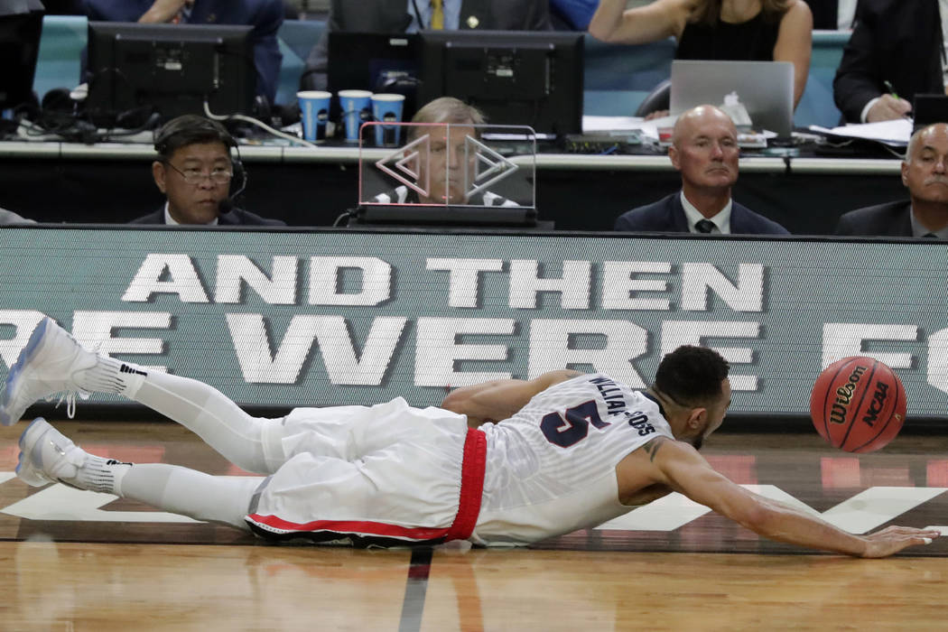 Gonzaga's Nigel Williams-Goss (5) dives for a loose ball during the second half in the semifinals of the Final Four NCAA college basketball tournament against South Carolina, Saturday, April 1, 20 ...