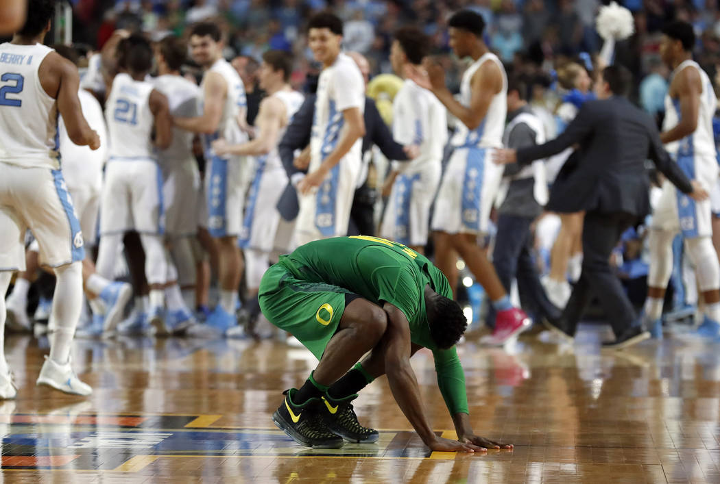 Oregon's Dylan Ennis reacts after the semifinals of the Final Four NCAA college basketball tournament against North Carolina, Saturday, April 1, 2017, in Glendale, Ariz. North Carolina won 77-76.  ...