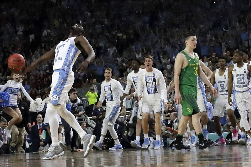 North Carolina's Theo Pinson (1) celebrates as Oregon's Payton Pritchard (3) walks off the court after the semifinals of the Final Four NCAA college basketball tournament, Saturday, April 1, 2017, ...