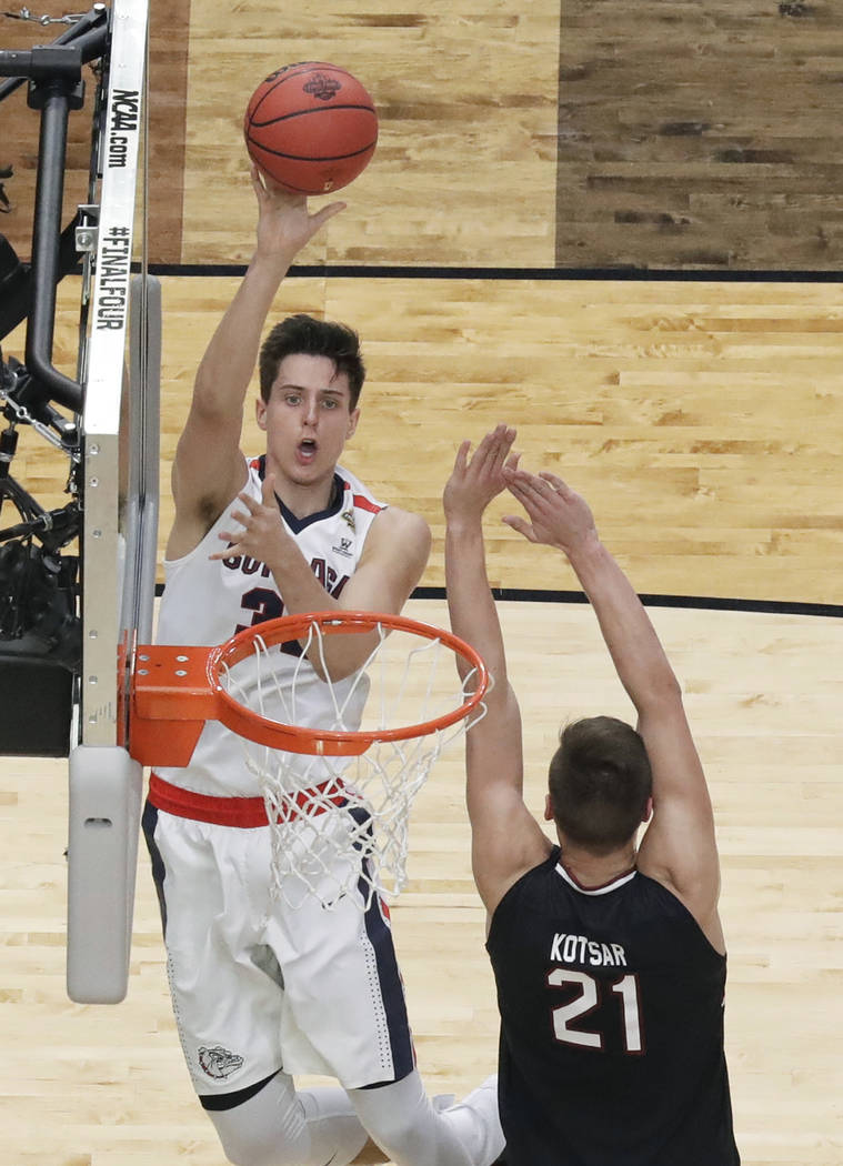 Gonzaga forward Zach Collins shoots over South Carolina forward Maik Kotsar (21) during the first half in the semifinals of the Final Four NCAA college basketball tournament, Saturday, April 1, 20 ...