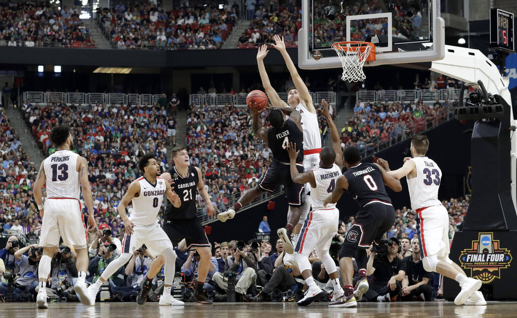 South Carolina's Rakym Felder (4) shoots against Gonzaga's Zach Collins during the first half in the semifinals of the Final Four NCAA college basketball tournament, Saturday, April 1, 2017, in Gl ...