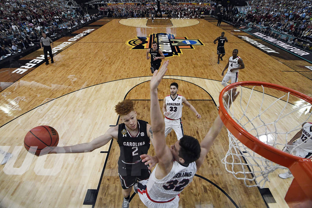 South Carolina's Hassani Gravett (2) takes a shot against Gonzaga's Zach Collins (32) during the first half in the semifinals of the Final Four NCAA college basketball tournament, Saturday, April  ...