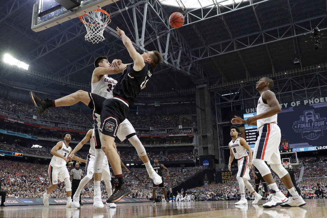 Gonzaga forward Zach Collins blocks a shot by South Carolina forward Maik Kotsar (21) during the second half in the semifinals of the Final Four NCAA college basketball tournament, Saturday, April ...