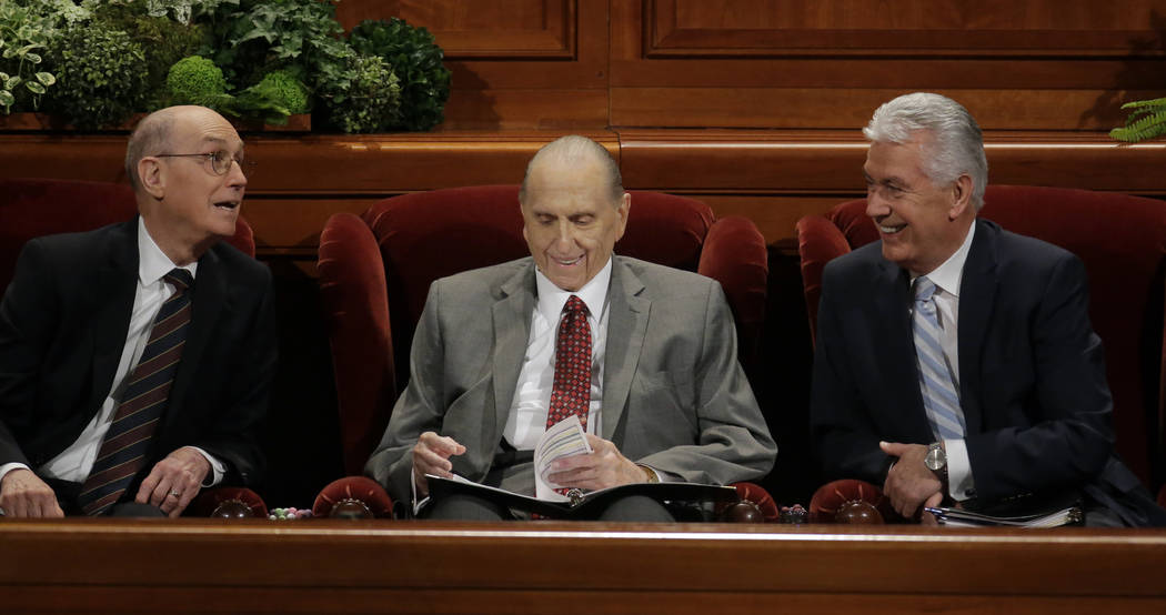 The Church of Jesus Christ of Latter-day Saints President Thomas S. Monson, center, First Counselor Henry B. Eyring, left, and Second Counselor Dieter F. Uchtdorf, right, look on during the mornin ...