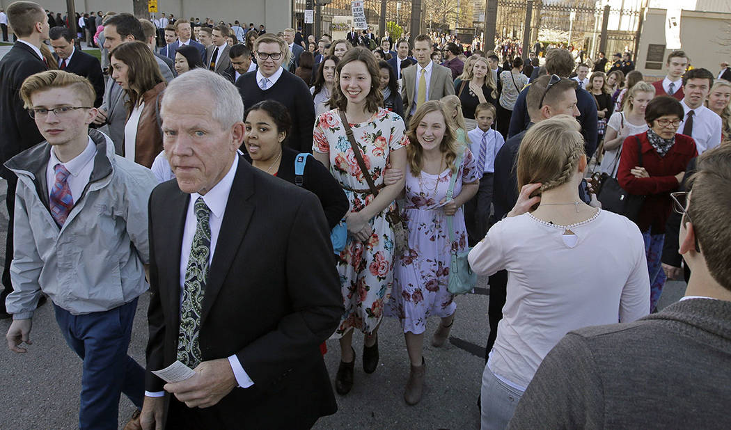 People arrive for the morning session of the two-day Mormon church conference Saturday, April 1, 2017, in Salt Lake City. Mormons will hear guidance and inspiration from the religion's top leaders ...