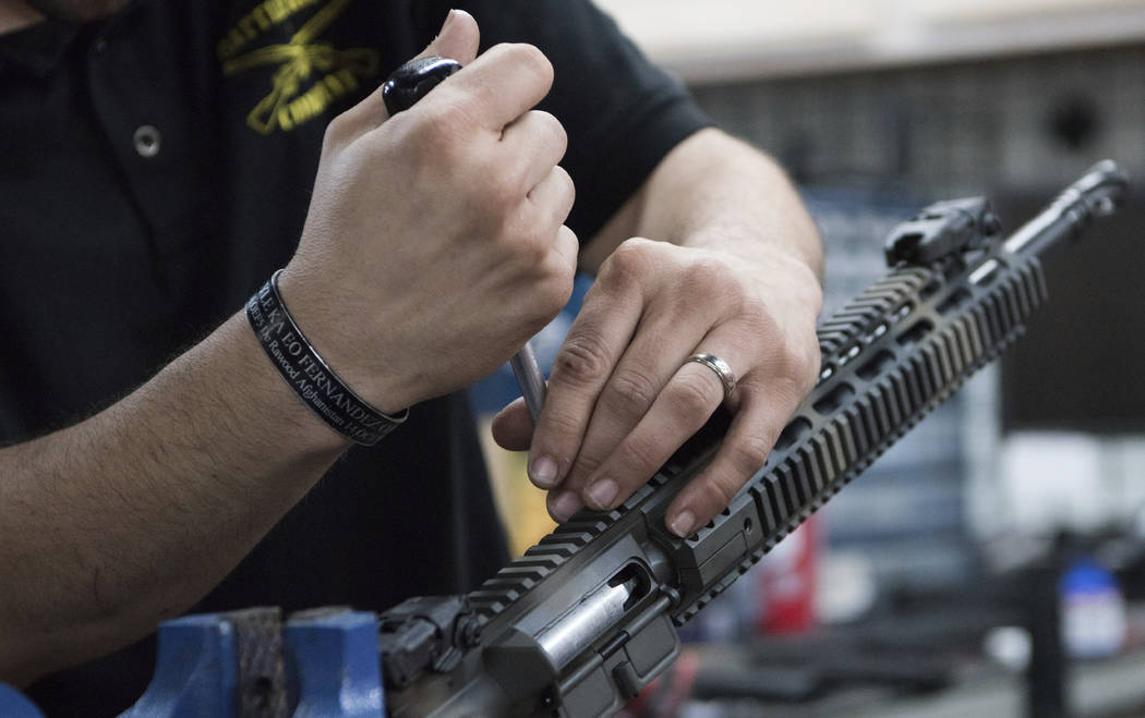 In this photo taken March 15, 2017, Karl Sorken, production manager for Battle Rifle Co., based in Webster, Texas, works on the rails of an AR-15 style rifle. (AP Photo/Lisa Marie Pane)
