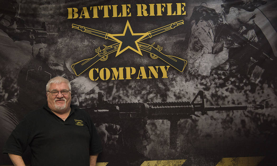 In this photo taken March 15, 2017, Chris Kurzadkowski, owner of Battle Rifle Co. for portrait near a wall adorned with his company's logo in Webster, Texas. (AP Photo/Lisa Marie Pane)