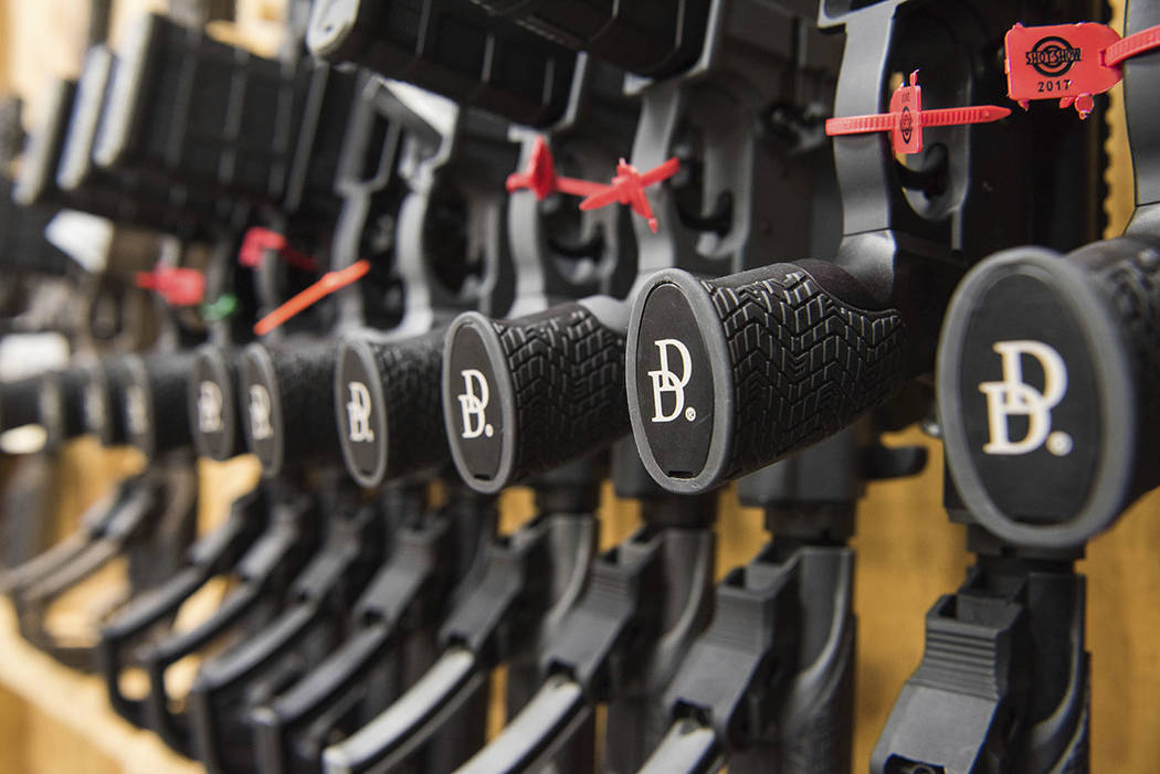 A row of AR-15 style rifles manufactured by Daniel Defense sit in a vault at the company's headquarters in Black Creek, Ga. T (AP Photo/Lisa Marie Pane)