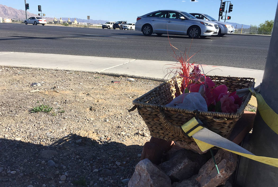 A makeshift memorial is affixed to a light pole near the corner of North Fifth Street and Craig Road in North Las Vegas on Sunday, April 2, 2017. (Blake Apgar/Las Vegas Review-Journal)