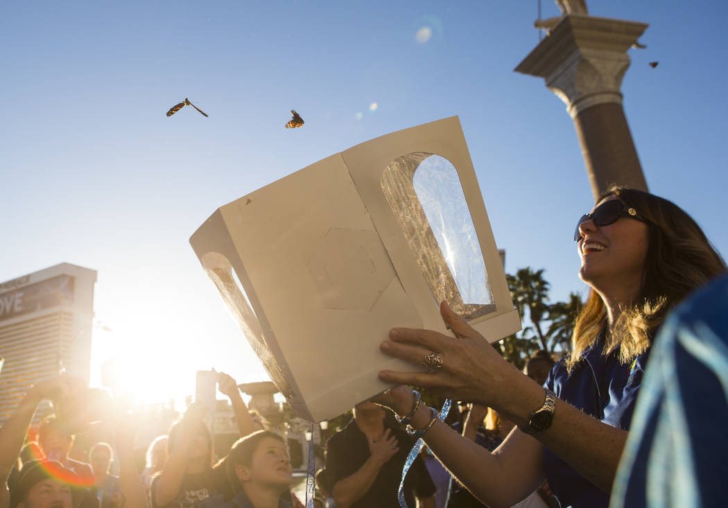 Grant a Gift Autism Foundation Founder/President and CEO Lynda Tache releases butterflies during an event honoring World Autism Awareness Day outside of The Venetian hotel-casino in Las Vegas on S ...