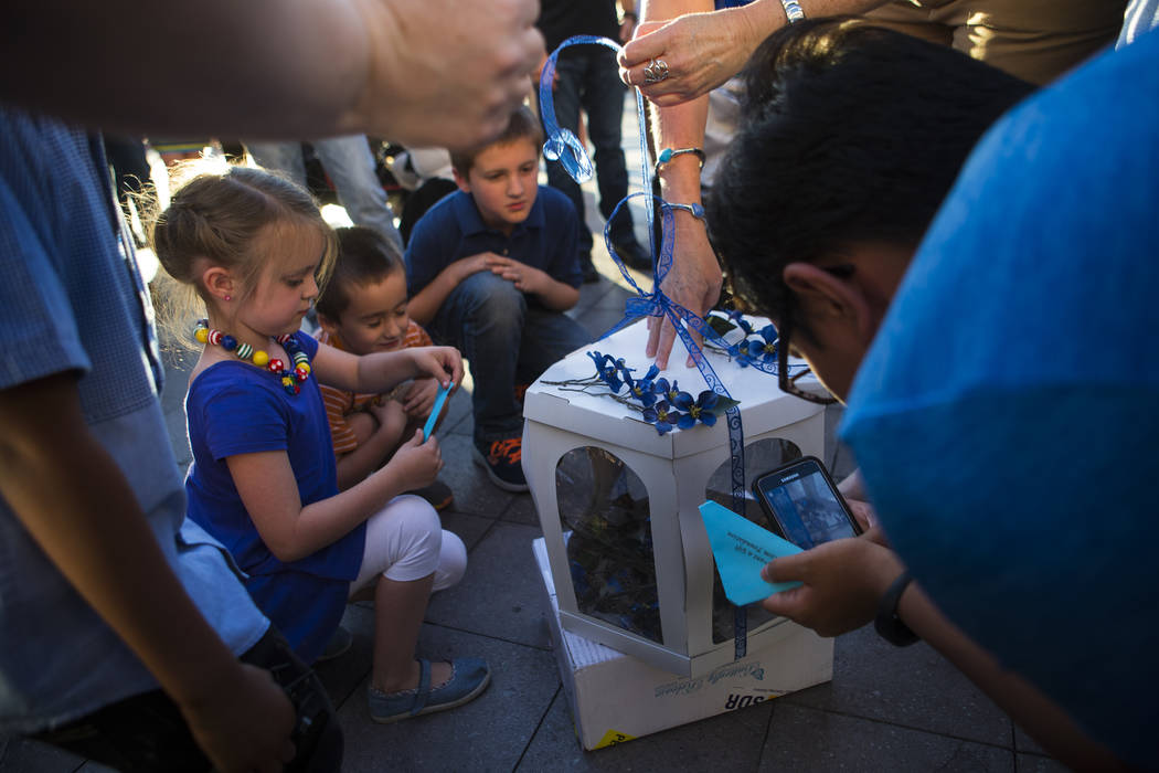 Children wait for butterflies to be released during an event honoring World Autism Awareness Day held by the Grant a Gift Autism Foundation outside of The Venetian hotel-casino in Las Vegas on Sun ...