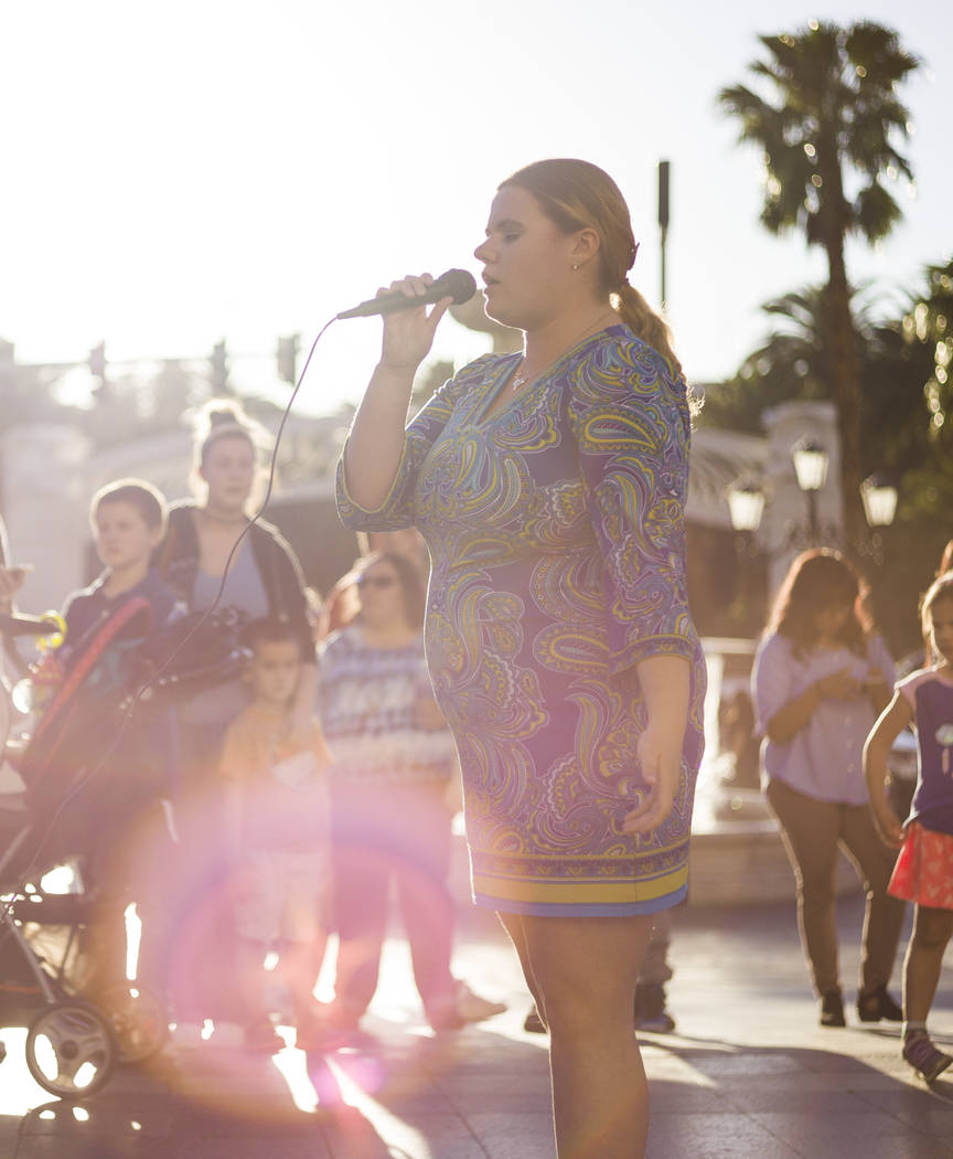 Megan Crandy performs a song before a butterfly release honoring World Autism Awareness Day held by the Grant a Gift Autism Foundation outside of The Venetian hotel-casino in Las Vegas on Sunday,  ...