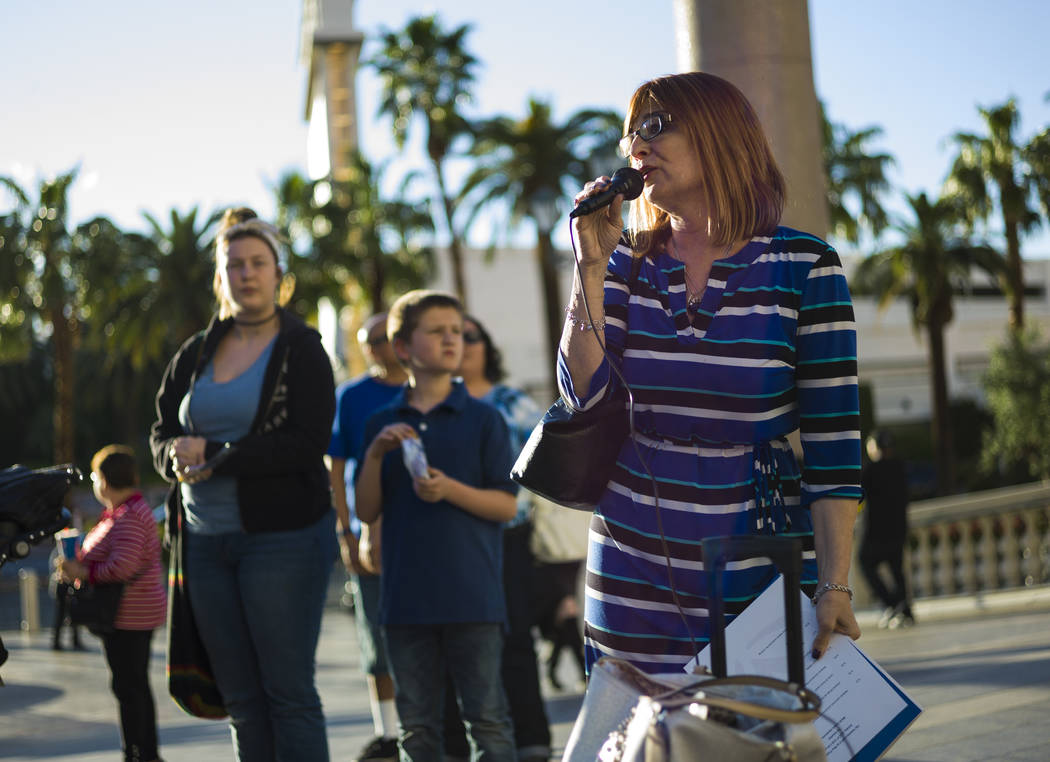 Melanie Bash, chief development officer at Grant a Gift Autism Foundation, before a butterfly release honoring World Autism Awareness Day outside of The Venetian hotel-casino in Las Vegas on Sunda ...