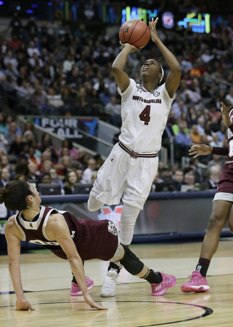 South Carolina guard Doniyah Cliney (4) shoots over Mississippi State guard Dominique Dillingham (00) during the first half in the final of NCAA women's Final Four college basketball tournament, S ...