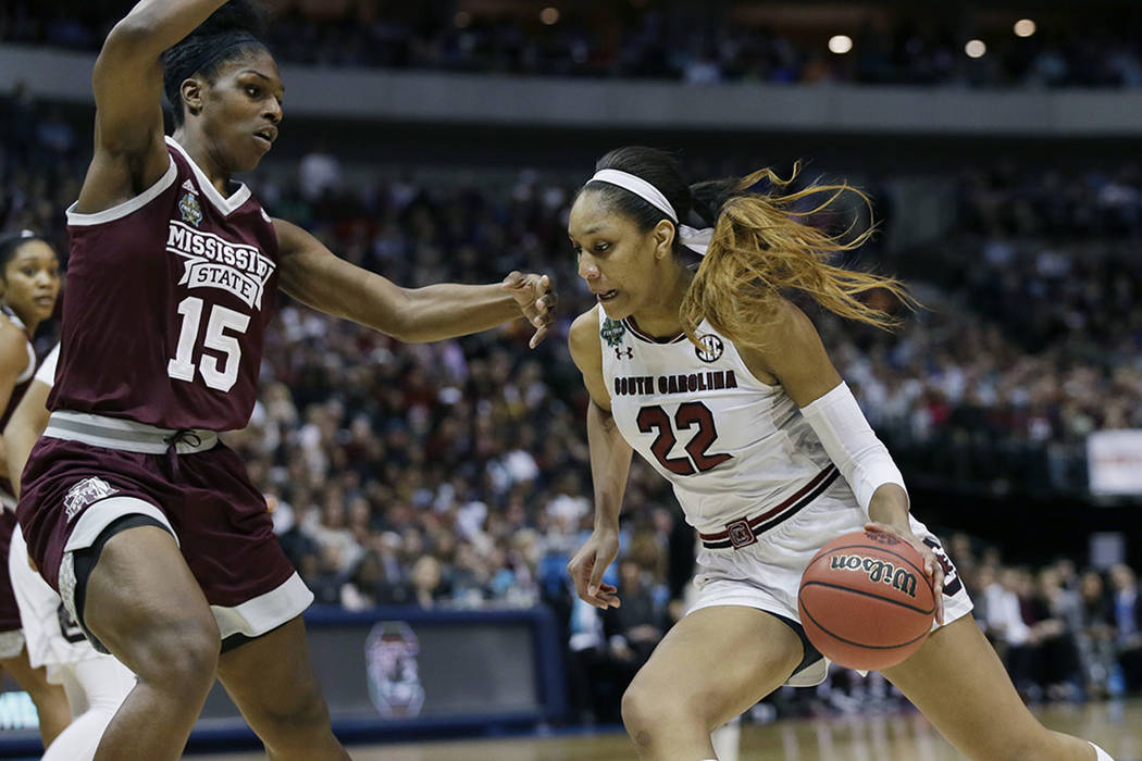 South Carolina forward A'ja Wilson (22) drives around Mississippi State center Teaira McCowan (15) during the first half in the championship game of the NCAA women's Final Four college basketball  ...