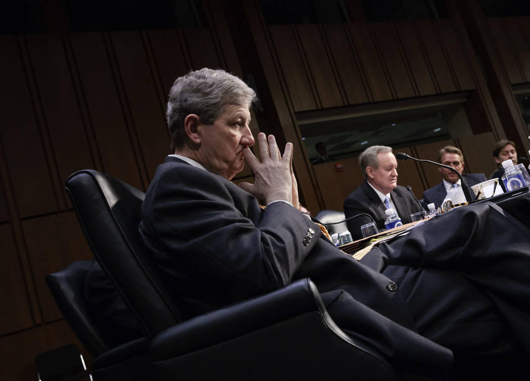 Sen. John Kennedy, R-La., listens as Sen. Mike Crapo, R-Idaho, rear, speaks in favor of President Donald Trump's Supreme Court nominee Neil Gorsuch in the Senate Judiciary Committee on Capitol Hil ...