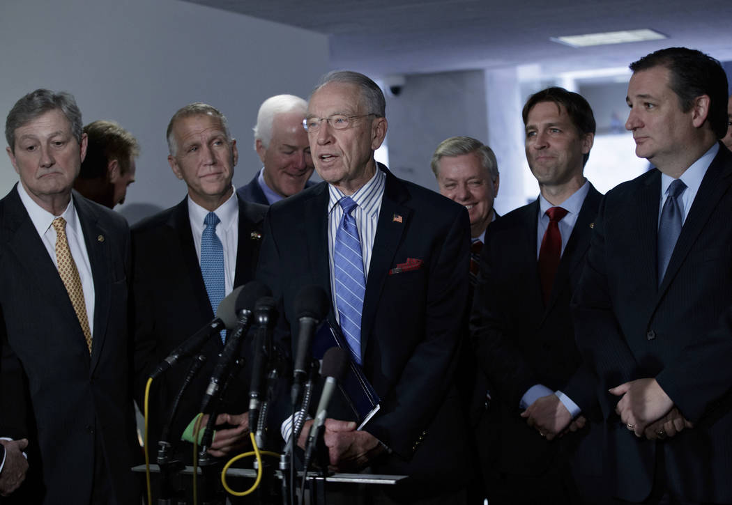 Senate Judiciary Committee Chairman Sen. Charles Grassley, R-Iowa, center, accompanied by GOP members of the panel, speak to reporters on Capitol Hill in Washington, Monday, April 3, 2017, after t ...