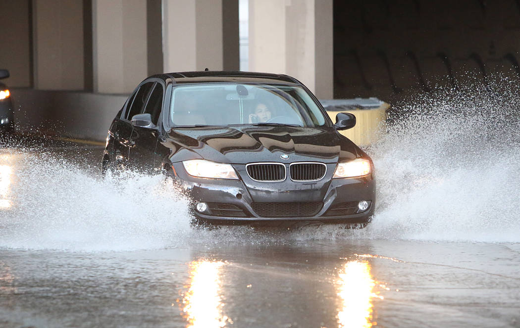 A Motorist navigates through a flooded street on Bonanza Road  during the afternoon rain on Monday, April 3, 2017, in Las Vegas. (Bizuayehu Tesfaye/Las Vegas Review-Journal) @bizutesfaye