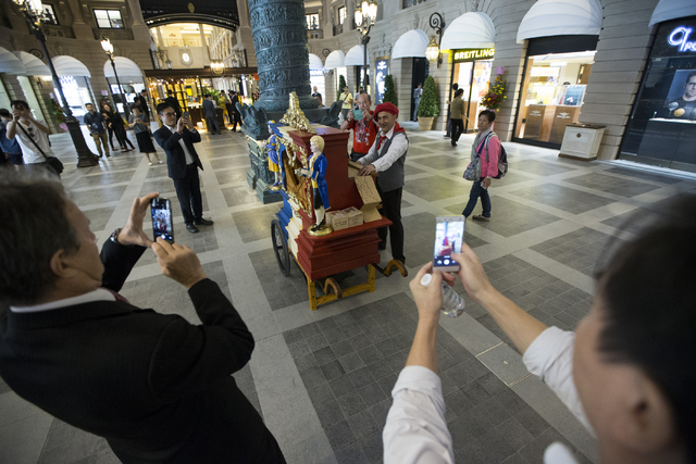 People photograph a music player inside the Parisian Macao hotel-casino on Wednesday, Sept. 14, 2016, in Macau. (Erik Verduzco/Las Vegas Review-Journal) @Erik_Verduzco