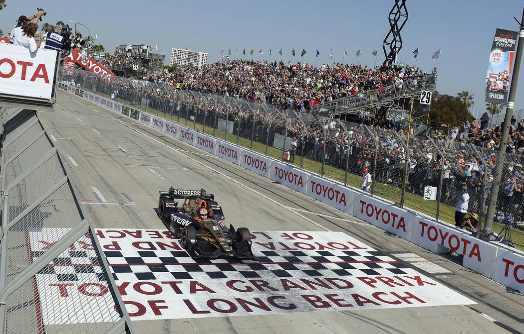 Indycar driver James Hinchcliffe takes the checkered flag to win the 43rd Toyota Grand Prix of Long Beach Sunday April 2017. (Will Lester/Los Angeles Daily News via AP)