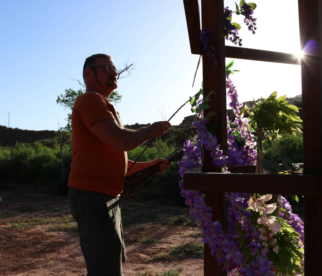 Brent Fitzpatrick decorates one of the towers he designed as part of an event attraction, Thursday, April, 13, 2017. Fitzpatrick owns a piece of land located west of Zion National Park. Gabriella  ...