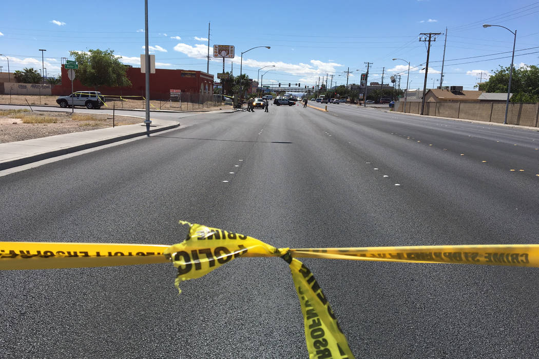 Police investigate after a bicyclist hit a curb and suffered a head injury in the east valley on Monday, April 3rd.(Bizuayehe Tesfaye/Las Vegas Review-Journal)