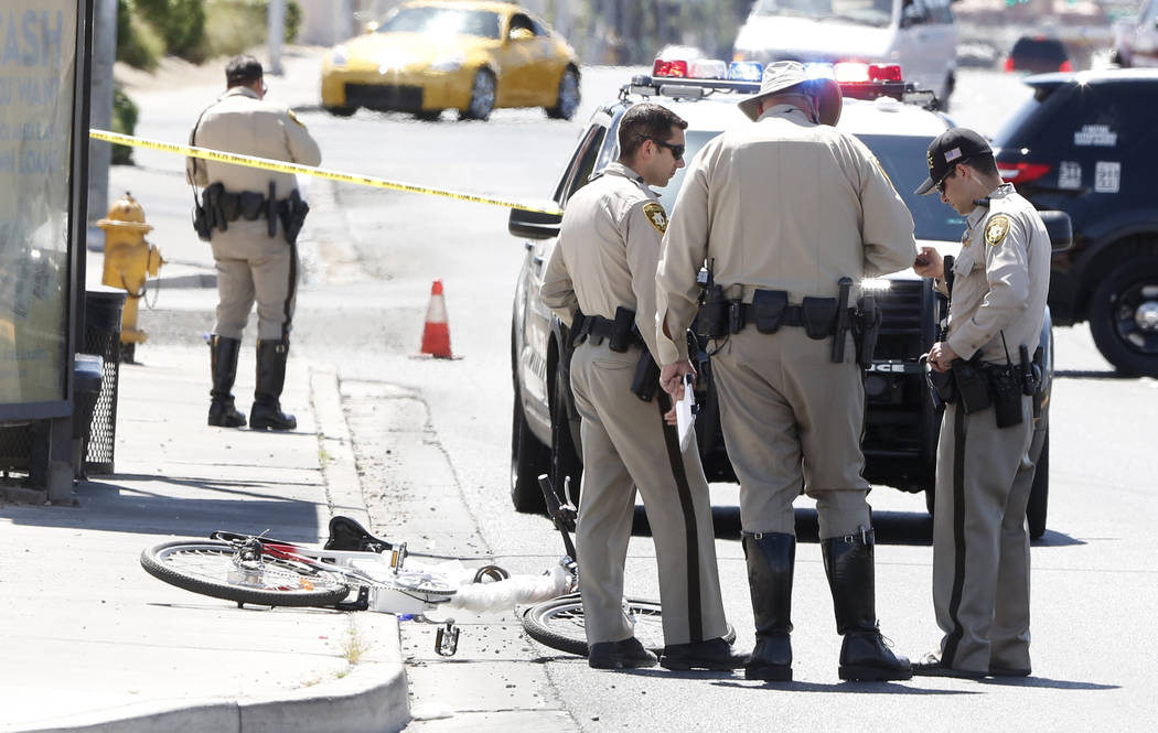 Police investigate after a bicyclist hit a curb and suffered a head injury near the intersection of Lamb Boulevard and Sahara Avenue on Monday, April 3, 2017, in Las vegas. (Bizuayehu Tesfaye/Las  ...