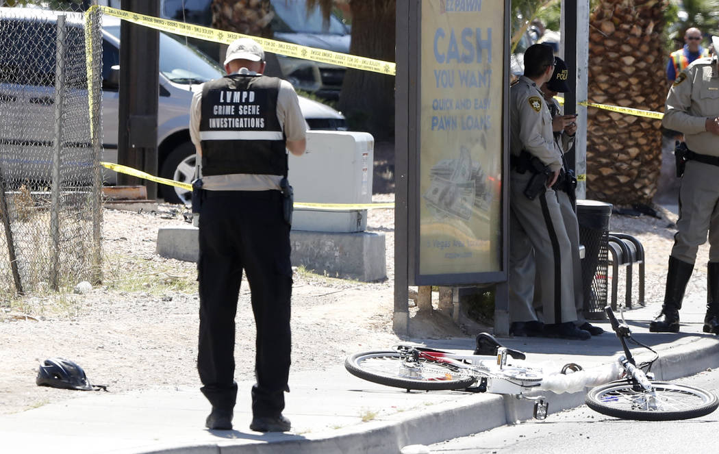 Police investigate after a bicyclist hit a curb and suffered a head injury near the intersection of Lamb Boulevard and Sahara Avenue on Monday, April 3, 2017, in Las vegas.(Bizuayehu Tesfaye/Las V ...