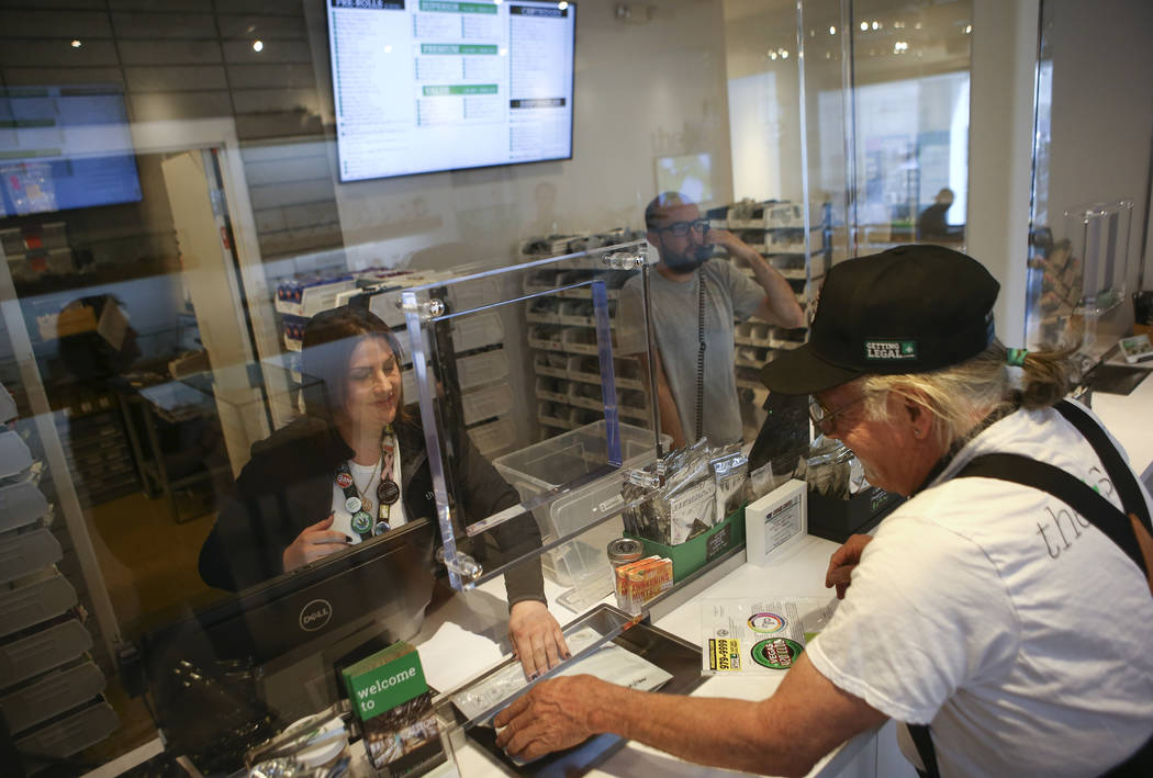 Kat Hernandez, left, a teller at medical marijuana dispensary The Source, assists Donald Solo in Las Vegas on Thursday, March 30, 2017. (Chase Stevens/Las Vegas Review-Journal) @csstevensphoto