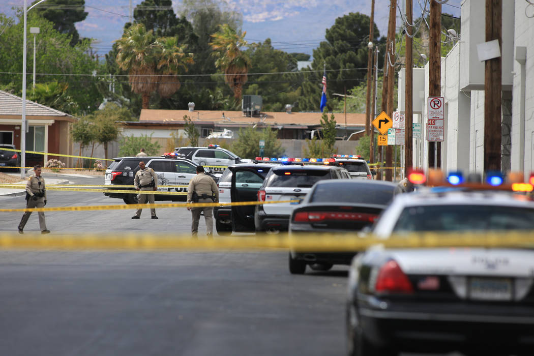 Las Vegas police investigate an officer-involved shooting on Westmoreland Drive, near Decatur Boulevard and Washington Avenue, in Las Vegas on Friday, March 31, 2017. (Brett Le Blanc Las Vegas Rev ...