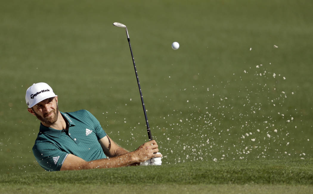 Dustin Johnson hits out of a bunker on the second hole during a practice round for the Masters golf tournament Tuesday, April 4, 2017, in Augusta, Ga. (AP Photo/Matt Slocum)