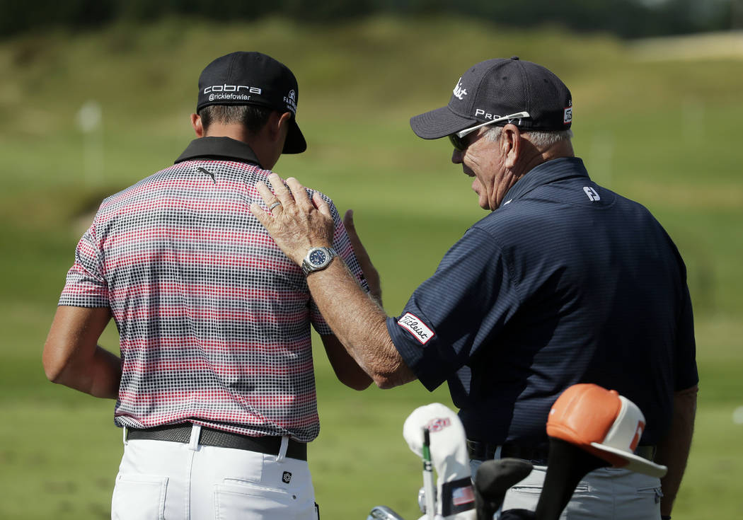 Butch Harmon talks to Rickie Fowler during a practice round for the PGA Championship golf tournament Wednesday, Aug. 12, 2015, at Whistling Straits in Haven, Wis. (AP Photo/Chris Carlson)