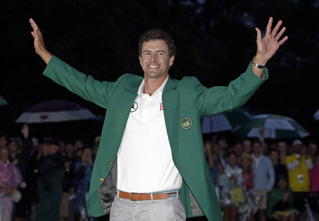 ADVANCE FOR WEEKEND EDITIONS, APRIL 5-6 - FILE - In this April 14, 2013 file photo, Adam Scott, of Australia, celebrates with his green jacket after winning the Masters golf tournament in Augusta, ...