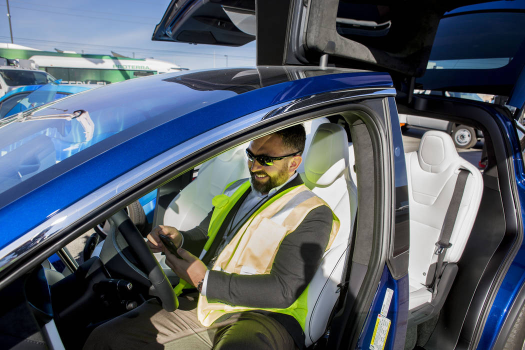 Daniel Fazekas, senior regional planner of Southern Nevada Strong, sits in a Model X Tesla SUV crossover is observed during a conversation about electric vehicles in Southern Nevada held by Region ...