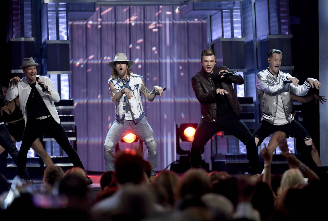 Brian Littrell, left, and Nick Carter, second from right, of Backstreet Boys, and Brian Kelley, second left, and Tyler Hubbard, right, of Florida Georgia Line, perform at the 52nd annual Academy o ...